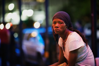 This homeless lady allowed me to take her picture in exchange for a couple of bucks. She became homeless after moving to Houston with her boyfriend. When things got tough, he started abusing her. She left him and decided living on the streets was a better option than living in physical abuse. (Houston, TX)