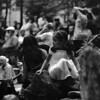 A photograph of a young girl enjoying the Friday Night Drum Circle at Pritchard Park in downtown Asheville, NC - 30 May 2014. Taken with a medium format Mamiya 6 on Ilford HP5+ film.