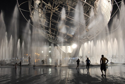 New Yorkers cooling off in the July heat under the Unisphere fountains in Flushing Meadow Park. (2011)  Location: Queens, N.Y.