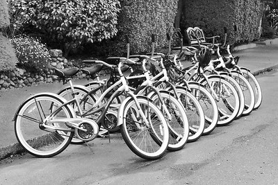 Waiting for a ride. A row of bikes in front of an inn in Ferndale, California.