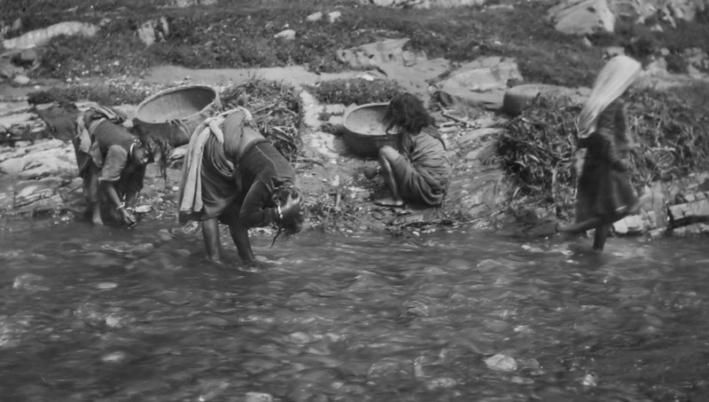Children washing in a river - India 1942