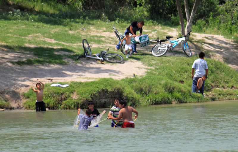 Mexican children from Piedras Negras playing in the Rio Grande River.
