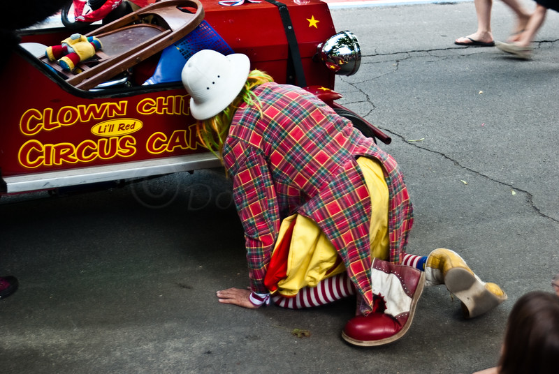 The clown has a little mechanical problem (for real) during a parade.