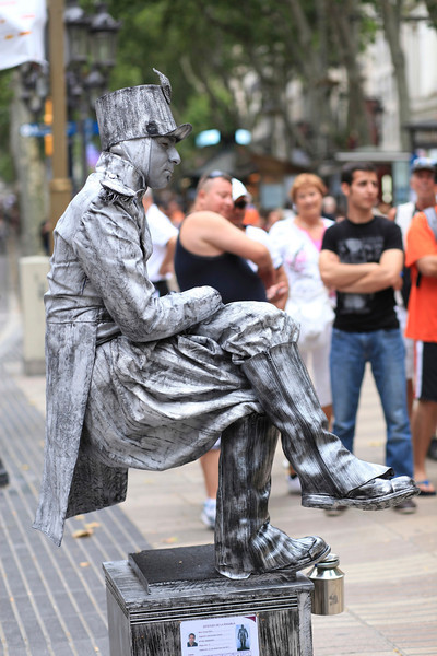 """Seen in Barcelona!! I am still trying to figure out how this Mime is able to """"sit"""" without any visible means of support, for hours on end. He is the """"Tin Man"""" yes, but if anyone can explain how he does this, that would be great."""