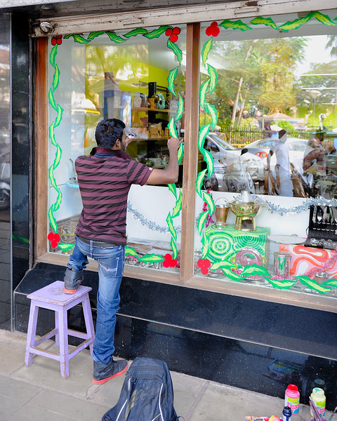 Wow, he's leaving it late!  Decorating shop front windows at 11:46 Christmas Eve!  I actually think he was just doing a touch-up :)