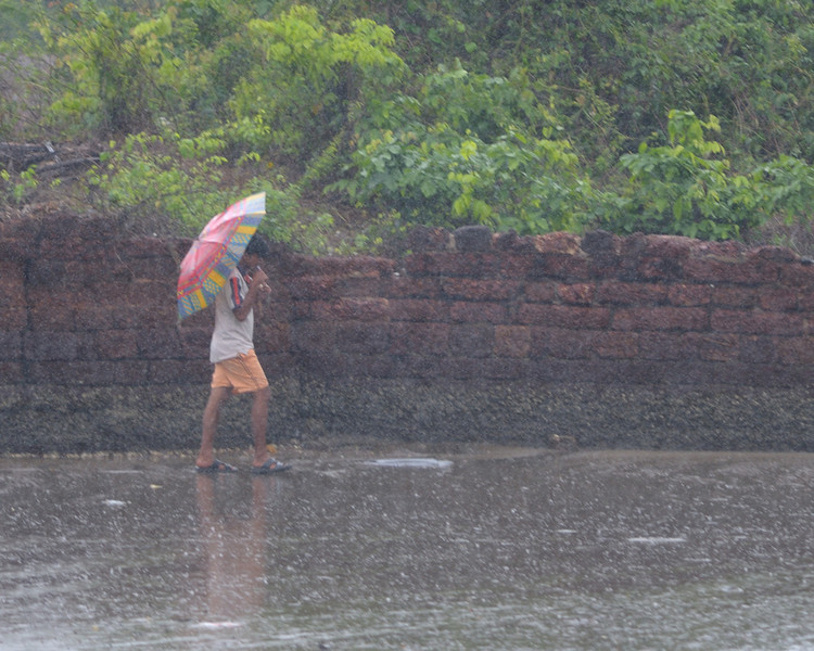 Umbrella is not much use, driving monsoon rain at Siolem