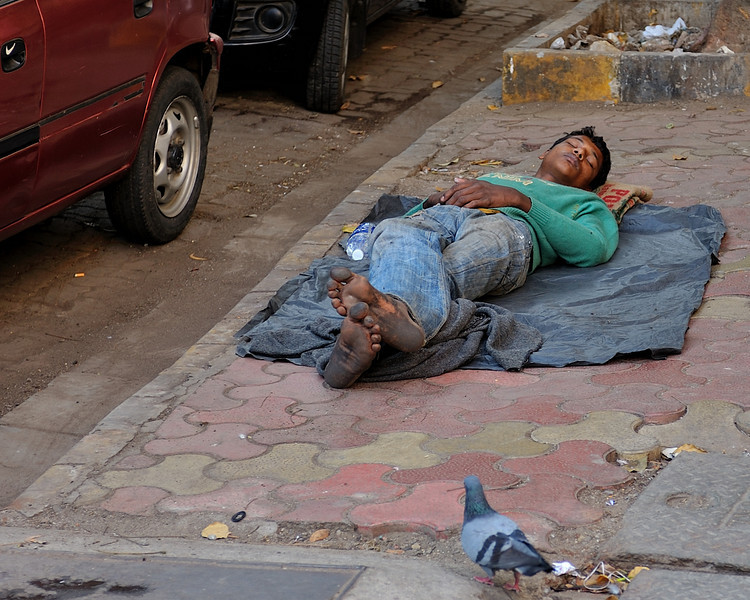 Not a homeless person.  He had just finished loading a truck, took the tarp out of the cab, lay down and went to sleep.  In about 3 minutes total!