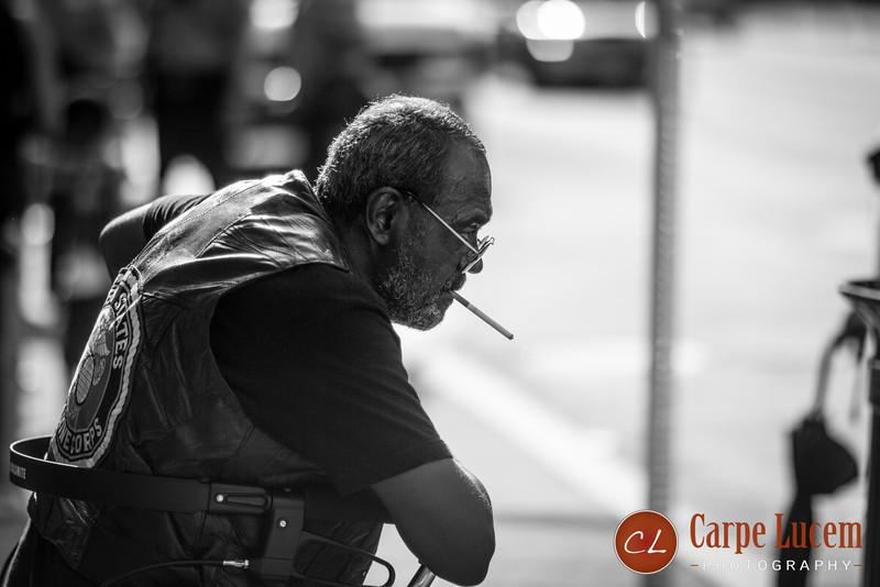 A veteran waiting for the bus on U Street, Washington, DC