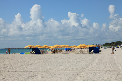 The sands of South Beach and yellow umbrellas.