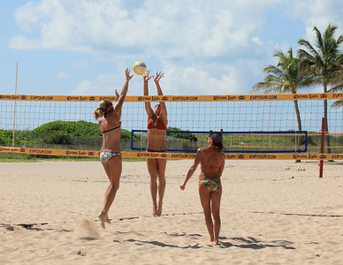 Volleyball at it's finest. Jump Ball and who can get it. South Beach, Florida.