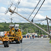A temporary pole is delivered to Summer Street in Fitchburg after a tractor trailer hit a low hanging wire, damaging three telephone poles in the process. SENTINEL & ENTERPRISE / Ashley Green