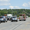 Summer Street in Fitchburg was closed down to traffic on Tuesday afternoon after a tractor trailer hit a low hanging wire, damaging three telephone poles in the process.