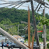 Summer Street in Fitchburg was closed down to traffic on Tuesday afternoon after a tractor trailer hit a low hanging wire, damaging three telephone poles in the process. SENTINEL & ENTERPRISE / Ashley Green