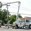 Unitil workers repair damaged telephone lines and turn off electricity on Summer Street in Fitchburg on Tuesday afternoon after a tractor trailer hit a low hanging wire, damaging three telephone poles in the process. SENTINEL & ENTERPRISE / Ashley Green