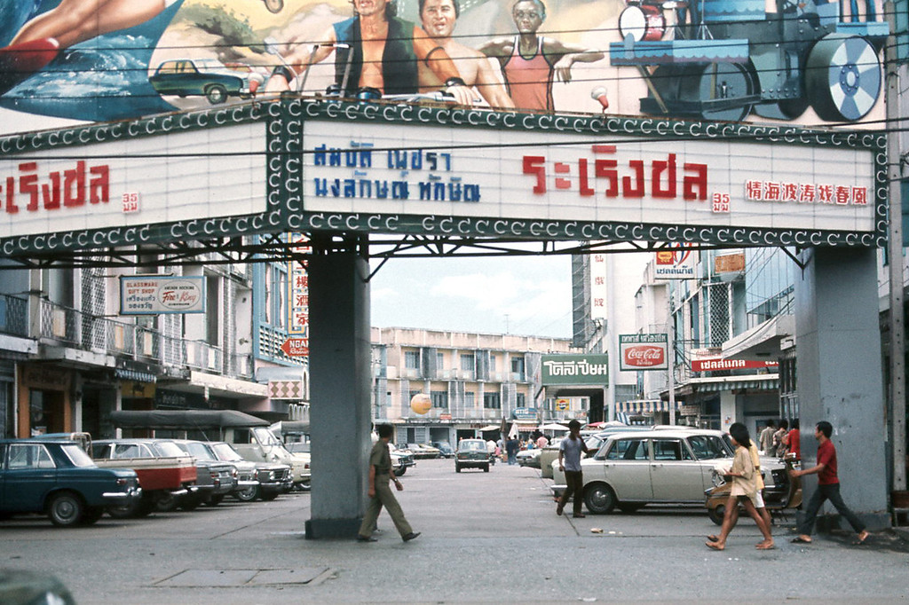 Movie marquee and shops in Bangkok.