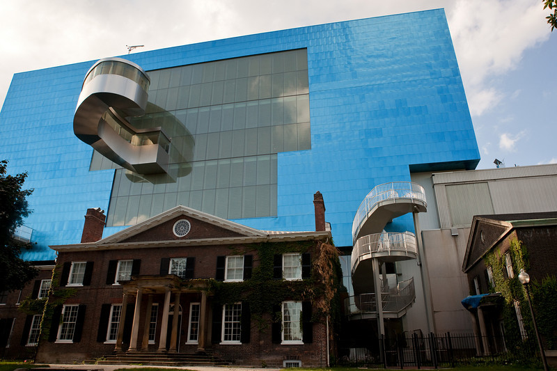 Frank Gehry's big blue cube overpowers The Grange, a famous Toronto mansion held by the Art Gallery of Ontario.
