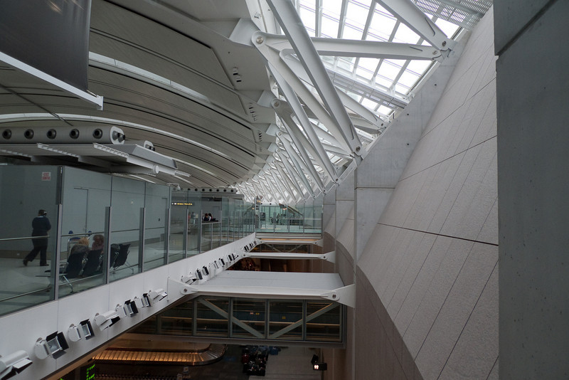 A view of the roof structure and bridges connecting the check-in area at Toronto International Airport with the security area and departure gates.