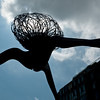 "A ""spider"" sculpture looms over a cafe patio in Toronto's Distillery District."