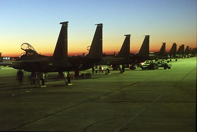 A row of F-15s sits on the Tyndall AFB, Florida, ramp. The F-15 Eagle is an all-weather, extremely maneuverable, tactical fighter designed to gain and maintain air superiority in aerial combat. The single-seat F-15C and two-seat F-15D models entered the Air Force inventory beginning in 1979. Kadena Air Base, Japan, received the first F-15C in September 1979. These new models have Production Eagle Package (PEP 2000) improvements, including 2,000 pounds (900 kilograms) of additional internal fuel, provision for carrying exterior conformal fuel tanks and increased maximum takeoff weight of up to 68,000 pounds (30,600 kilograms). (U.S. Air Force photo)