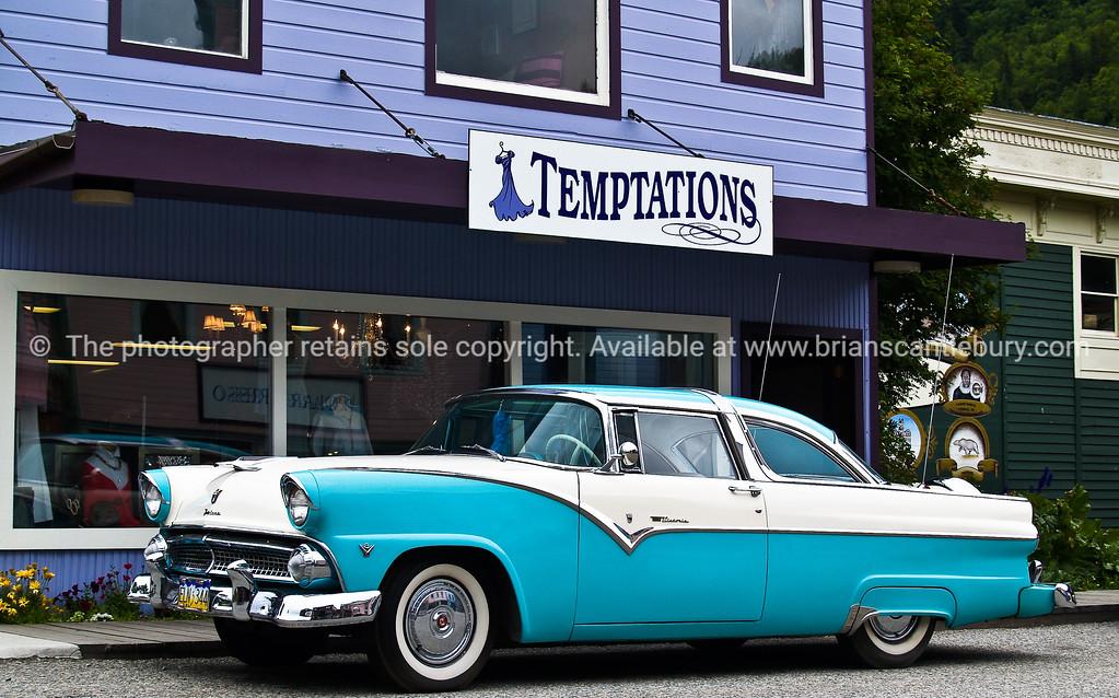 """Vintage car, V8, outside """"Temptations"""" shop, Skagway, Alaska."""