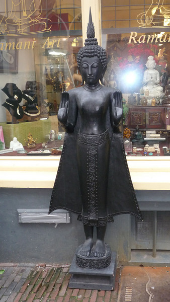 Statue in front of a shop