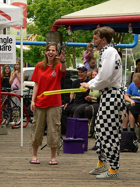 """Series """"The Juggler"""" #4 of 6<br /> <br /> She redeemed herself in the 2nd act and now he is going to reward her with a balloon toy.  I can't recall exactly what he said but you know it was a double entendre from her face and the man wearing the black cap in the background.<br /> <br /> ."""