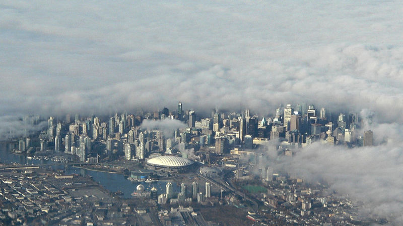 Vancouver in the fog.  Shot from about 2700 meters high and about 8 km distance.