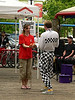 "Series ""The Juggler"" #1 of 6<br /> <br /> At Granville Island in Triangle Square near the Public Market.  This young lady volunteered.  Here the Juggler is setting her up for her first ""act"".<br /> <br /> I ran into him again the following day at a different venue.  He is formally known as ""The Checkerboard Guy"".  Check out his website... <a href=""http://www.checkerhead.com"">http://www.checkerhead.com</a><br /> <br /> ."