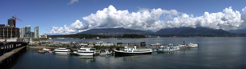 Vancouver harbour on Canada Day.  Looking straight out to Stanley Park with Cypress Mountain in the background.<br /> <br /> 2003-07-01_harbour_a2