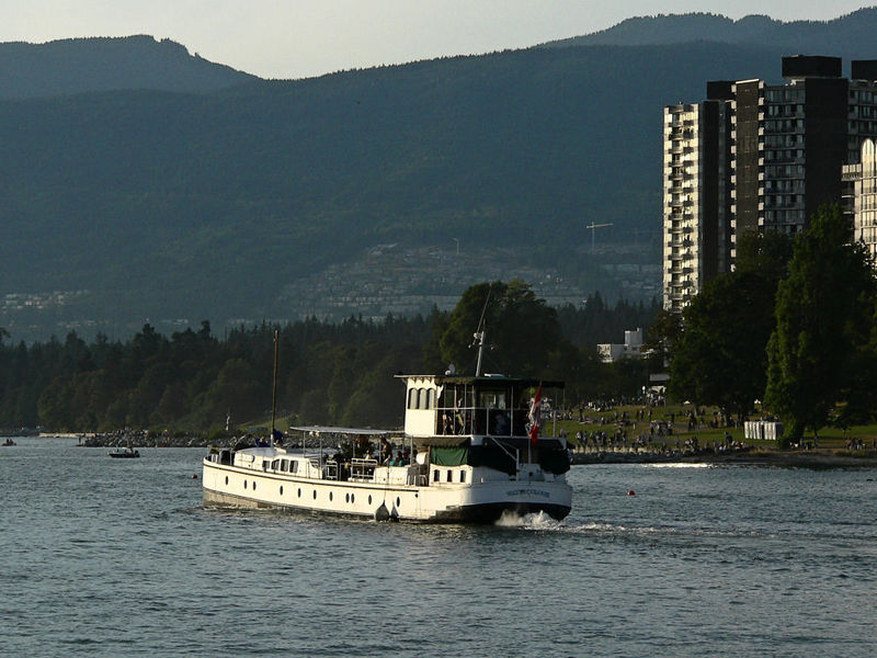 Motorized barge on it's way out of False Creek heading to anchor in English Bay prior to Vancouver's Celebration of Light fireworks competition.