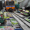 Here comes the train! Maeklong Railway Market (Talad Rom Hub): railway market near Bangkok