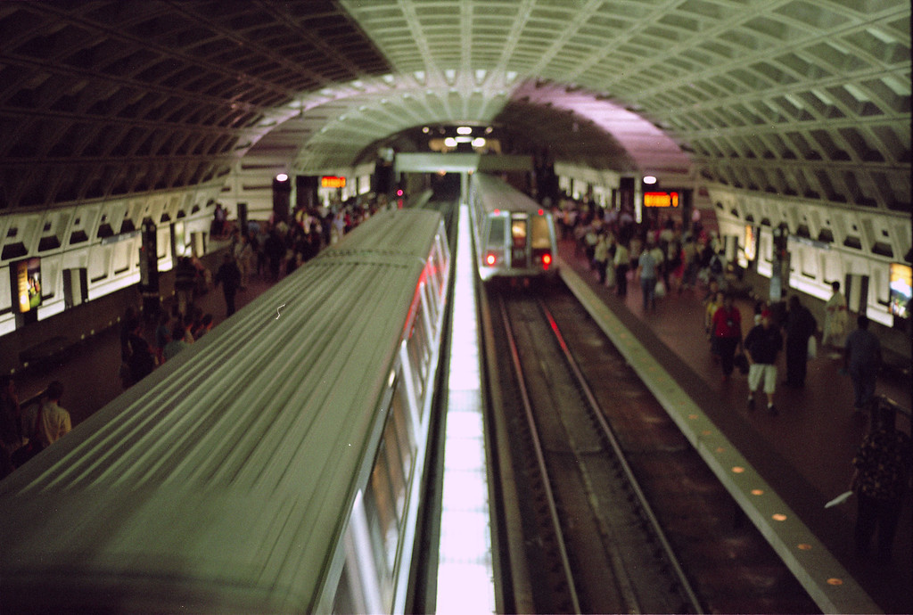 A view from above at Metro Center as both trains begin to leave