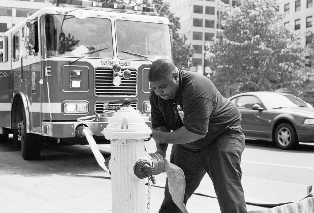 A fireman opens a hydrant on Connecticut Avenue in Washington, DC