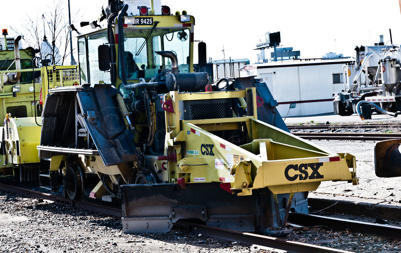 CSX Bed clearing and rail cleaning maintenance machine
