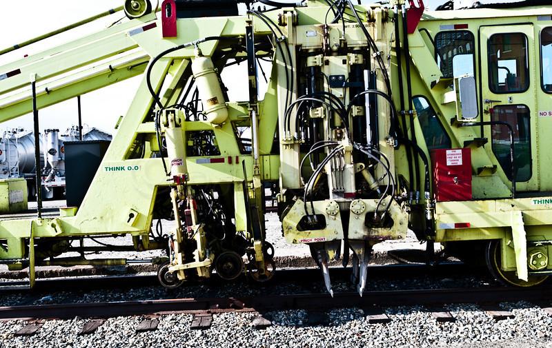 Detail of CSX rail alignment maintenance machine.