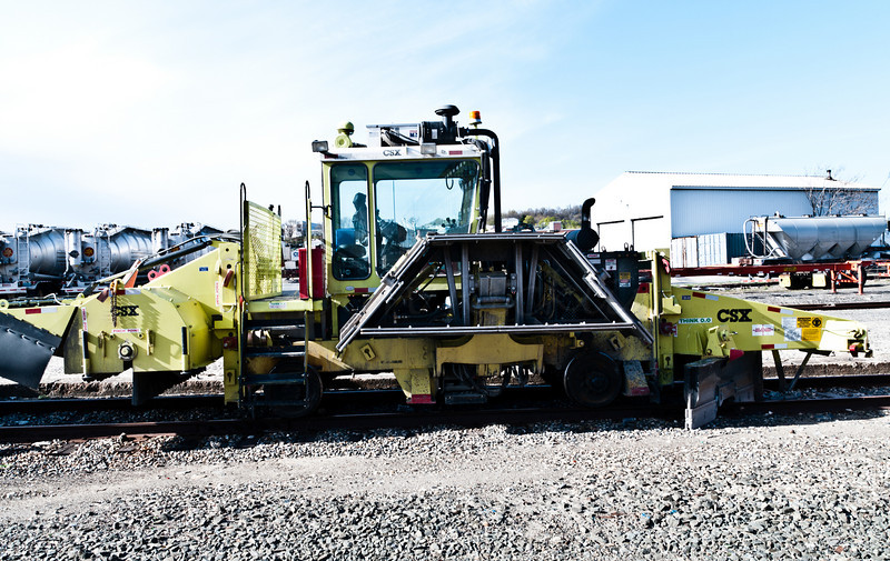 Another view of the CSX Bed clearing and rail cleaning maintenance machine