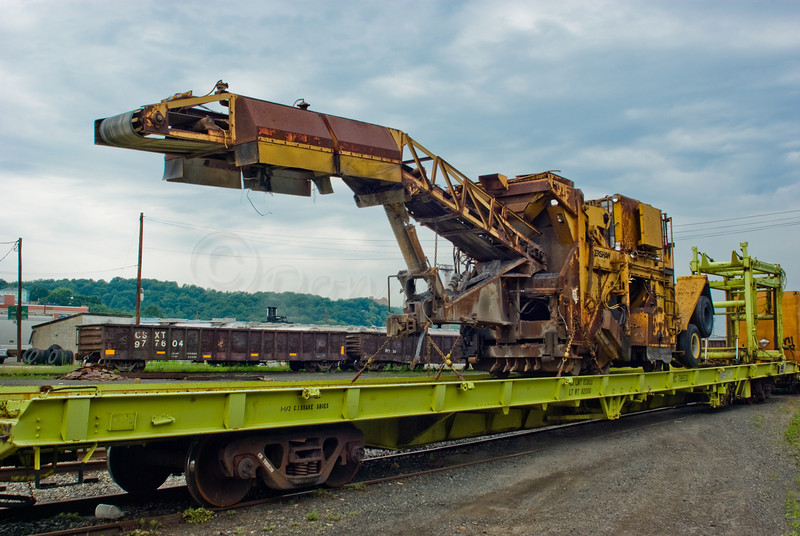 Special Railbed Equipment in the Intermodal yard on a stretch flatbed car. by