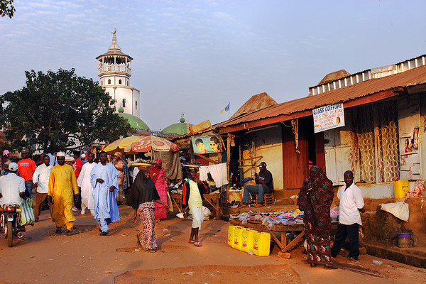 Exit of the market with the mosquee in the background, Foumban, Cameroon.