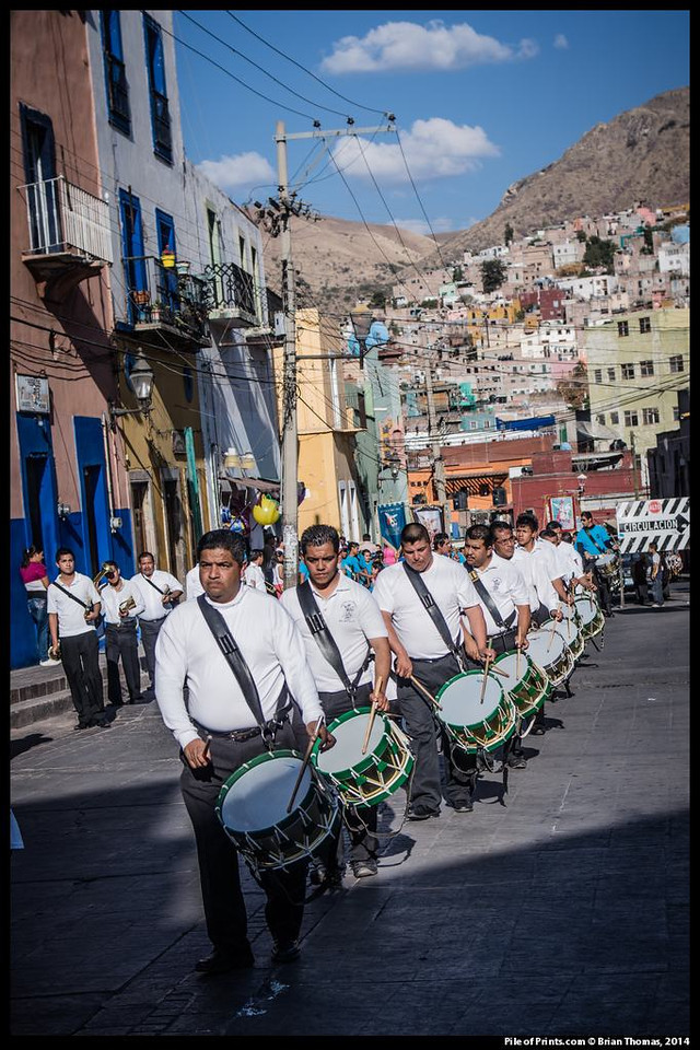 On the Sunday before Lent a parade winds through the streets of the narrow ravine in which Guanajuato nests. The ravine filled up long ago. The town has no new buildings.