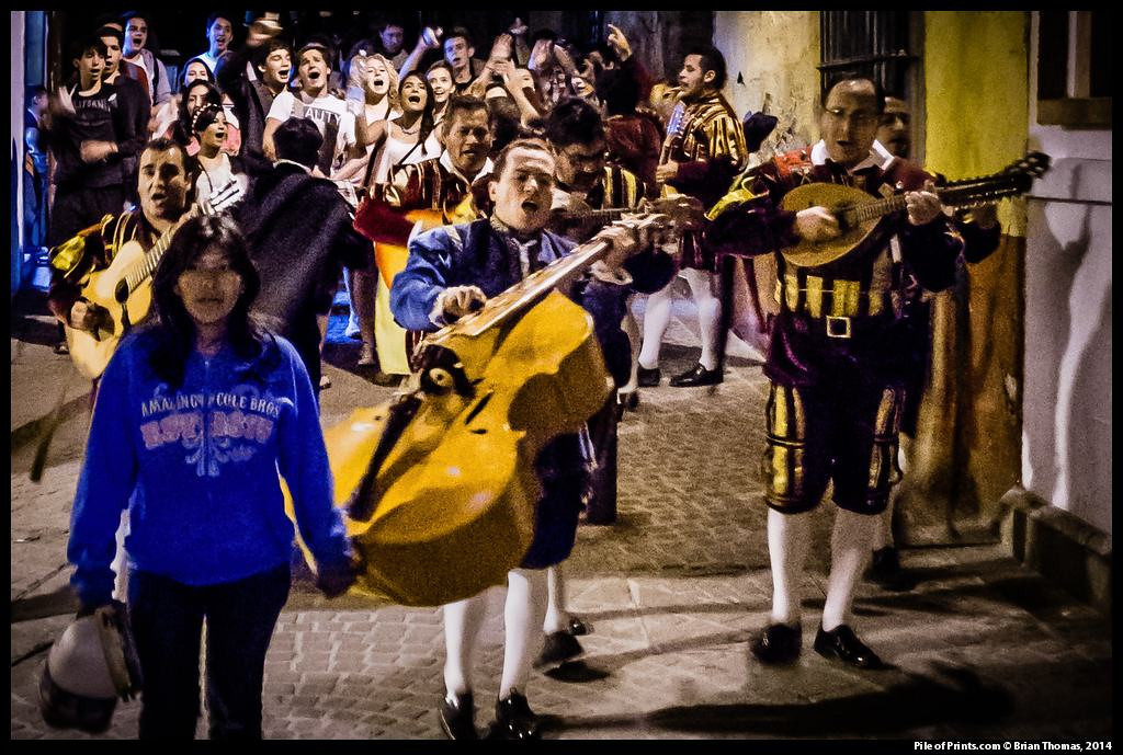 With old Spanish love songs university students lead a singing and drinking tour of the twisting alleyways of the old town.