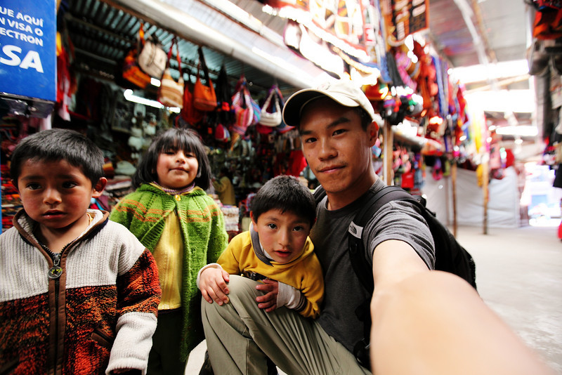 Cusco Market Rug Rats - They like me.....(or my camera)