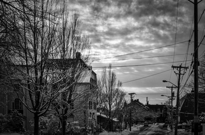 Cloudy evening on snowy Park Street, mono
