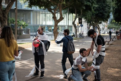 Group on street with toilet paper
