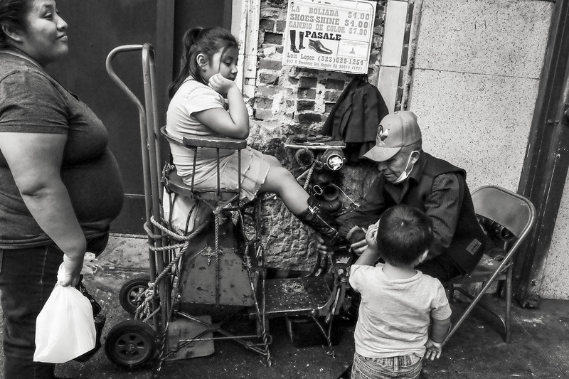 Shoe shine on Broadway between 6th and 7th Streets
