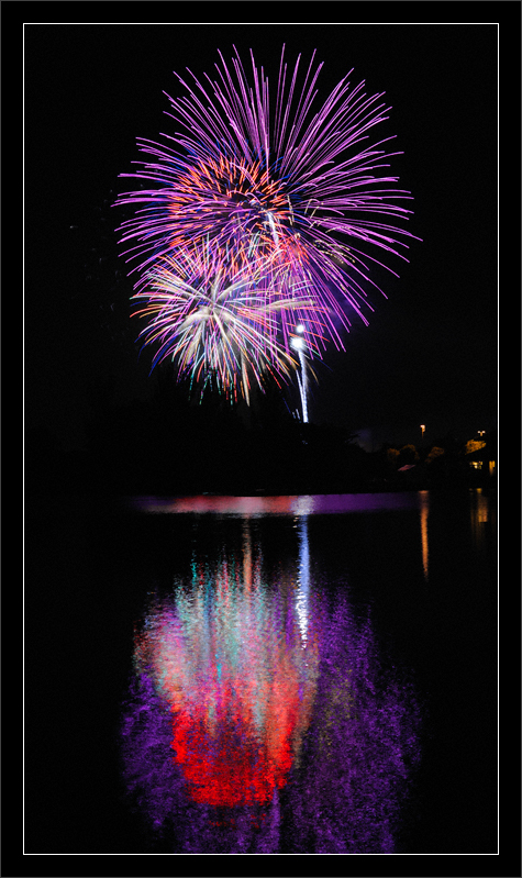 Fireworks & Rippled Lake Reflections  Forth-of-July fireworks celebration (a day early)  over the Shoreline boathouse and lake  Shoreline Park Mountain View, California  03-JUL-2011