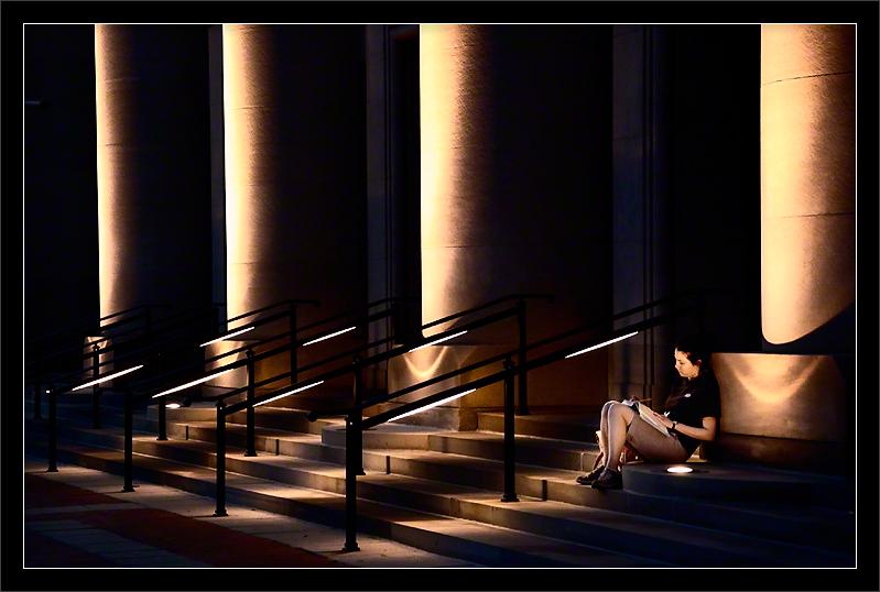 Handrail Assistance  With a pillar as her backrest, a student studies on a quiet summer evening on the well-lit steps of Hill Auditorium.   Hill Auditorium University of Michigan, Ann Arbor  22-JUN-2008