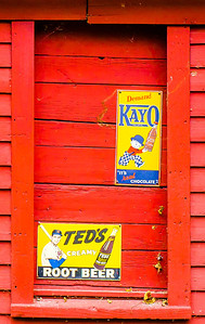 Red barn with adverts