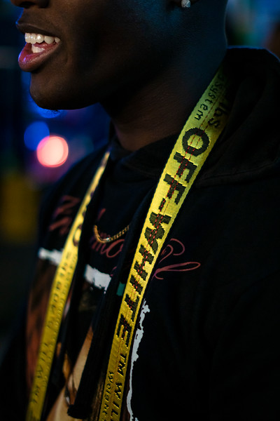 Deon with Off White camera strap.