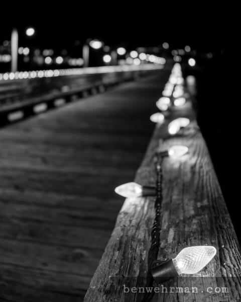 String lights on wooden handrail