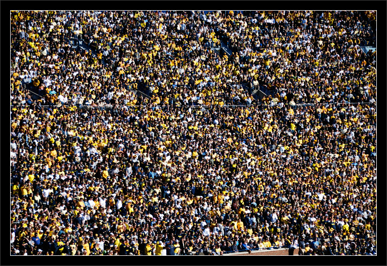 Homecoming: 109,750  Partial view into the east seating sections  Michigan wolverine fans gather for homecoming at the Big House.  The recorded attendance was 109,750.  Michigan Stadium University of Michigan, Ann Arbor  04-OCT-2008